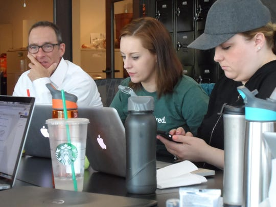 Steven Burt, left, of Ridge House, works with Julia Kruper and Katie Coleman of KPS3 at a Reno Wired event in 2014 where design and marketing professionals teamed to produce a new website, logo, printed materials, PowerPoint show and a communications plan for Ridge House.