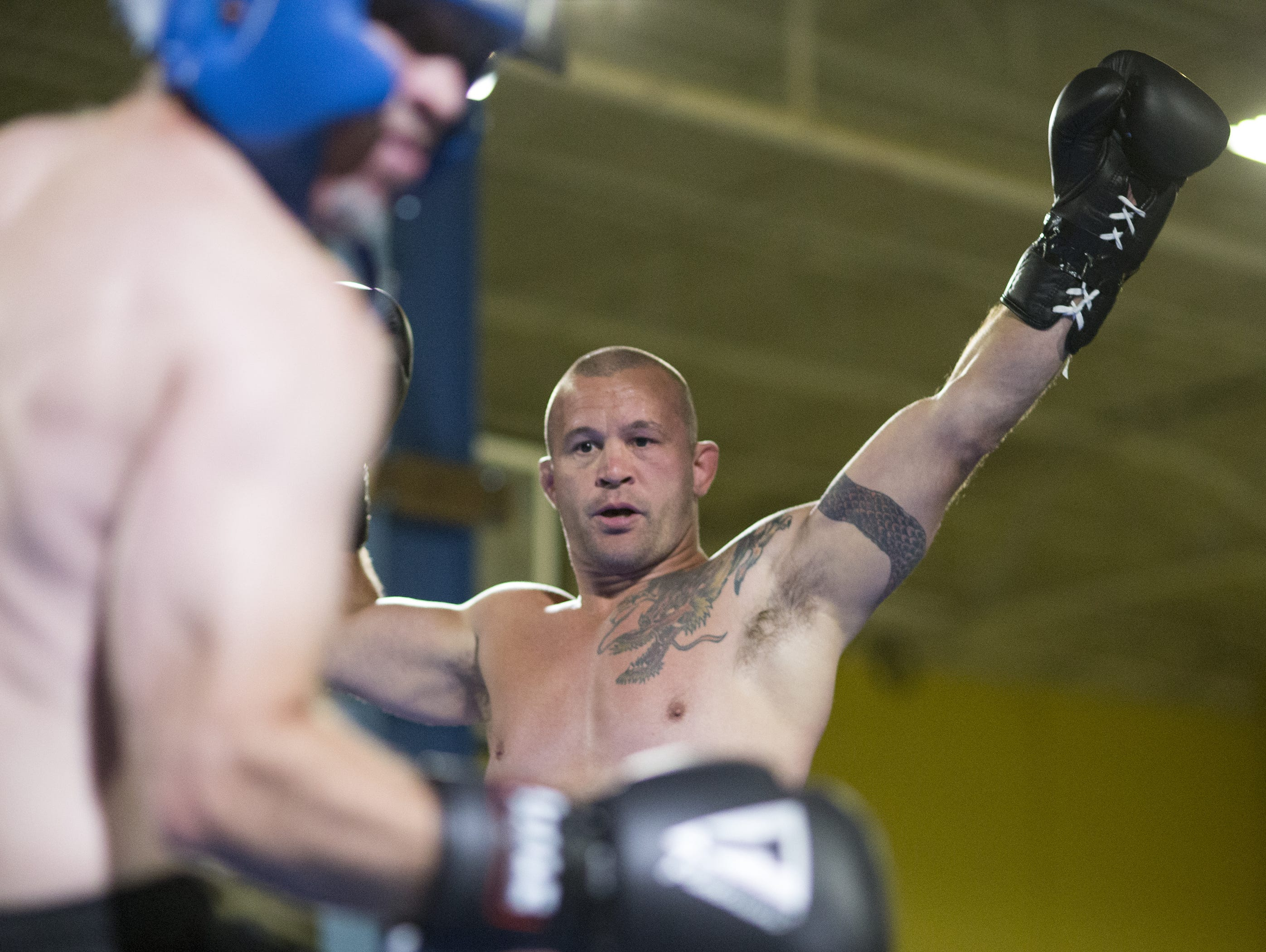 Former UFC fighter Chris Lytle taunted IndyStar columnist Gregg Doyel on Aug. 7, 2015, as they mixed it up during a charity event for Rock Steady Boxing, Indianapolis.