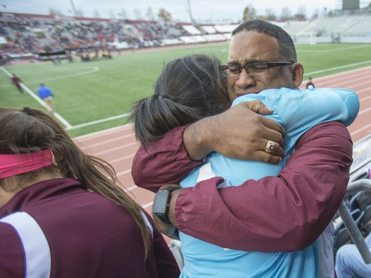 Troy Turner embraces his daughter Lauren Turner, following Brebeuf Jesuit's Class 2A State Soccer Finals win. Lauren's mother Stephanie had terminal cancer and was able to see Brebeuf beat Penn 2-1.