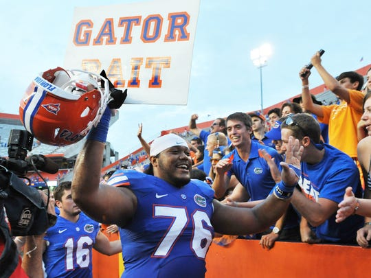 Florida offensive lineman Max Garcia celebrates with fans after a 31- 17 victory against the Tennessee Volunteers.