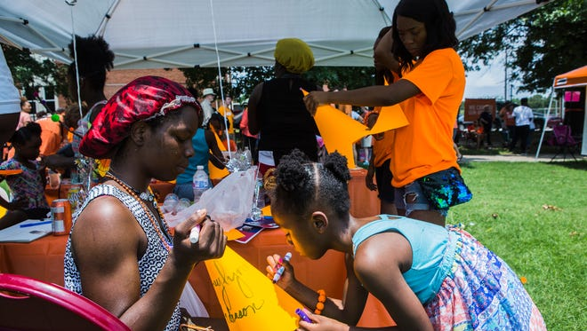 June 2, 2018 - Ebony Howell, 19, watches her niece, Zaylynn Anderson, 6, design a hat during the Wear Orange Block Party at Howze Park on Saturday. The event, hosted by the Memphis chapter of Moms Demand Action for Gun Sense in America, had activities for kids and families as well as a remembrance for victims and survivors of gun violence.