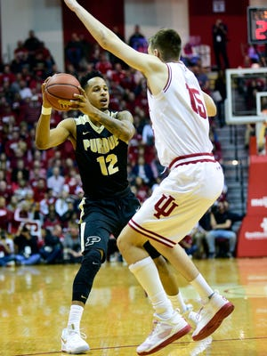 Purdue Boilermakers forward Vince Edwards (12) looks for an open teammate past Indiana Hoosiers guard Zach McRoberts (15) during the second half of the game at Assembly Hall on Feb. 9.
