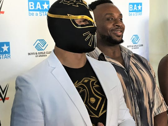 Sin Cara and Big E speak at a news conference at the Boys and Girls Club of El Paso Monday.