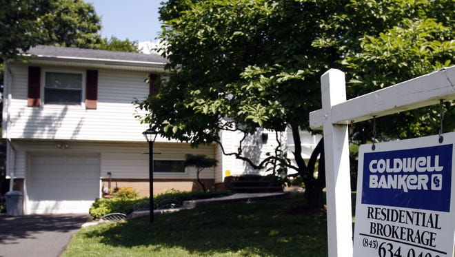 """A """"for sale"""" sign is visible on the front lawn of a home in Blauvelt."""