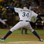 Seattle Mariners starting pitcher Felix Hernandez throws against the Oakland Athletics in the seventh inning of their baseball game Saturday, Sept. 5, 2015, in Oakland, Calif. (AP Photo/Eric Risberg)