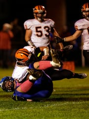 It's not unusual to find Amherst senior lineman Michael