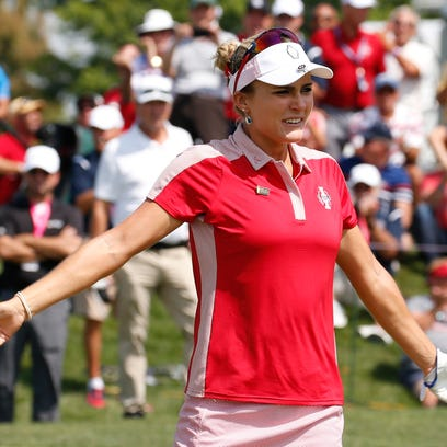 Lexi Thompson celebrates after she and Cristie Kerr