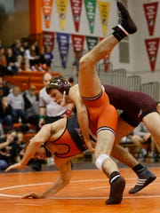 Dowling's Trevor Schwager takes down Valley's Joe Nicholson