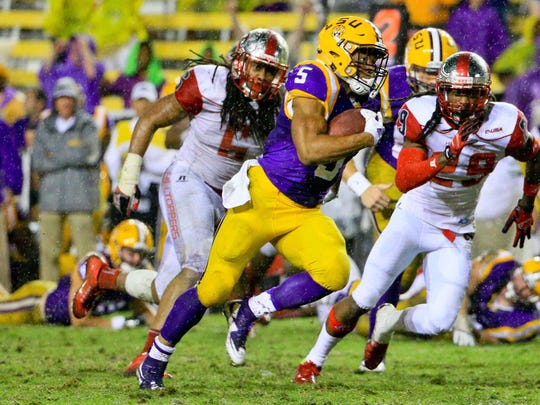 LSU Tigers running back Derrius Guice (5) runs for