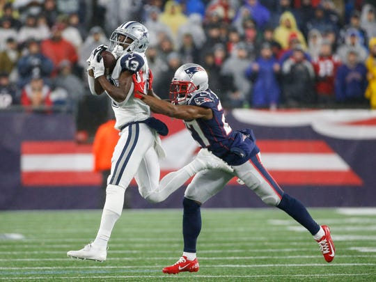 Nov 24, 2019; Foxborough, MA, USA; Dallas Cowboys wide receiver Michael Gallup (13) makes a reception while defended by New England Patriots cornerback J.C. Jackson (27) during the second half at Gillette Stadium. Mandatory Credit: Greg M. Cooper-USA TODAY Sports