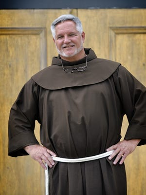 """Father Patrick Tuttle, pastor of St. Anthony of Padua Catholic Church, says the people of his church """"teach us about community, because they actually do know their neighbors day-to-day, and their issues."""""""
