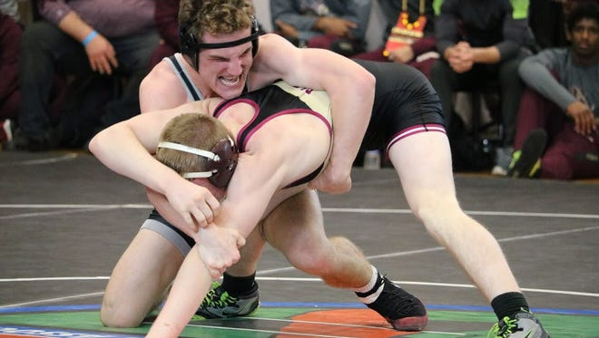 Jensen Beach High School wrestler Jake Tuschman (top) controls Riverdale's Coleby Barnes during the 138-pound match of a Class 2A state semifinal dual meet Saturday, Jan. 20, 2018 at Osceola High School in Kissimmee.
