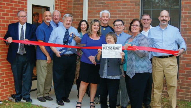 Representatives of Williamson County, the City of Fairview, the Fairview Area Chamber and the Fairview Public Library gather to cut the ribbon on the library's new addittion October 15, 2015.