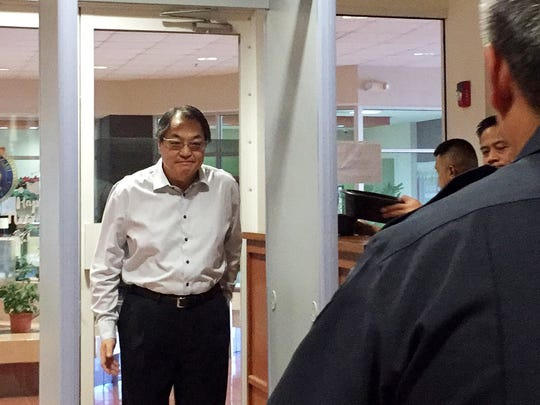 In this December 2016 file phot, John C.J. Shen, president of Shen Corporation, enters the Superior Court of Guam Northern Court satellite. Shen on Oct. 13 was indicted on charges of multiple felony counts of conspiracy to commit record tampering, conspiracy to commit identity theft and theft in an alleged luxury car fraud scheme.