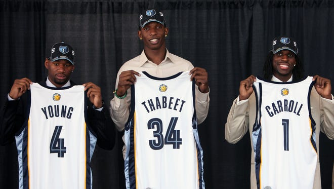 Memphis Grizzlies draft picks, from left, Sam Young, Hasheem Thabeet and DeMarre Carroll hold up their new team jerseys at a press conference June 26, 2009.