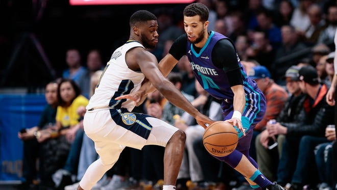 Denver Nuggets guard Emmanuel Mudiay (0) defends against Charlotte Hornets guard Michael Carter-Williams (10) in the first quarter at the Pepsi Center.