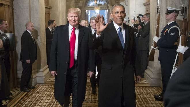 Donald Trump and Barack Obama arrive for Trump's inauguration ceremony at the Capitol on Jan. 20, 2017.