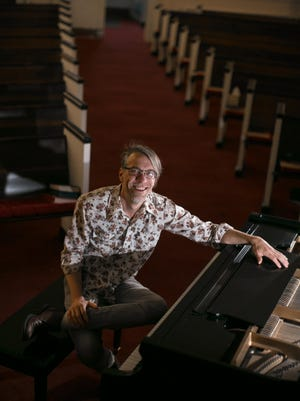 Pianist Aaron Price poses for a portrait at West Asheville Presbyterian Church on Saturday, February 10th. Colby Rabon (colbyrabon@gmail.com) February 10, 2018