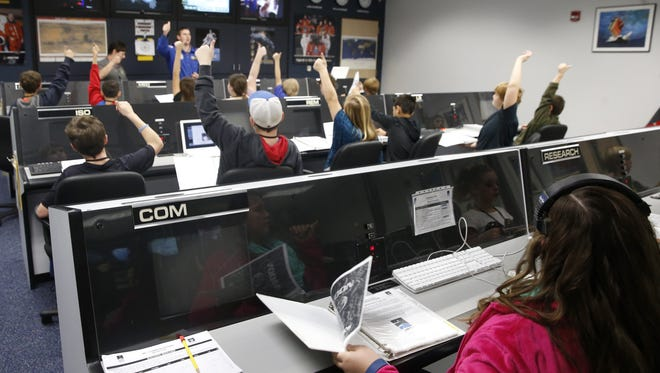 Children work in 'Mission Control' at the Challenger Learning Center downtown on Friday, one of the interactive NASA related learning modules at the downtown facility.