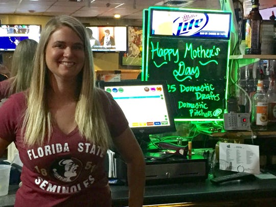 Bartender Christina Brady at The 4th Quarter Bar &