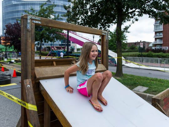 Lila Vollman, 7, races through the Mighty Titans obstacle