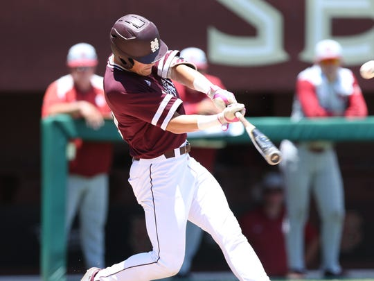 Mississippi State's Elijah MacNamee connects on a home run ball against Oklahoma.