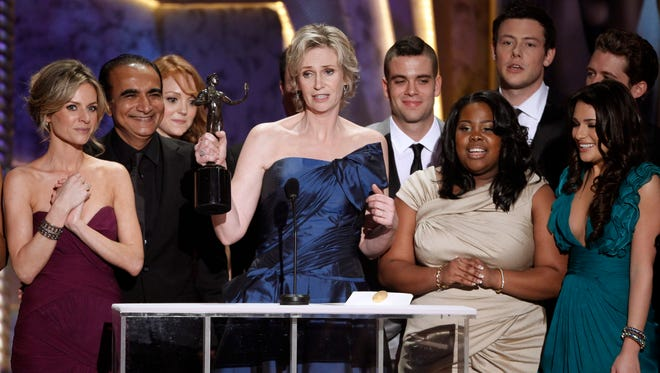 """Jane Lynch, center, and the cast of """"Glee"""" accept the award for best ensemble in a comedy series at the 16th Annual Screen Actors Guild Awards in Los Angeles on Jan. 23, 2010."""