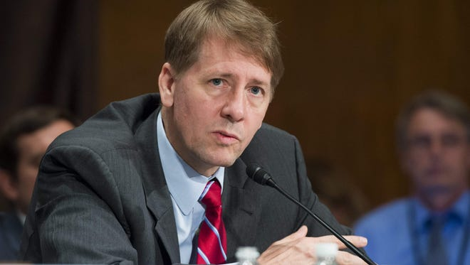 File photo taken in 2016 shows Richard Cordray, director of the Consumer Financial Protection Burea, testifying at a congressional hearing about unauthorized opening of accounts by Wells Fargo.