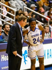 Shakena Richardson (right) confers with Seton Hall