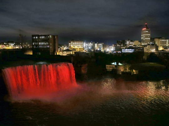 High Falls glow bright red.