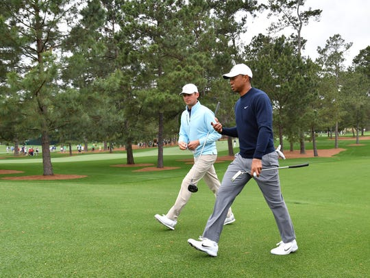 Matt Parziale (left) and Tiger Woods walk to the 3rd