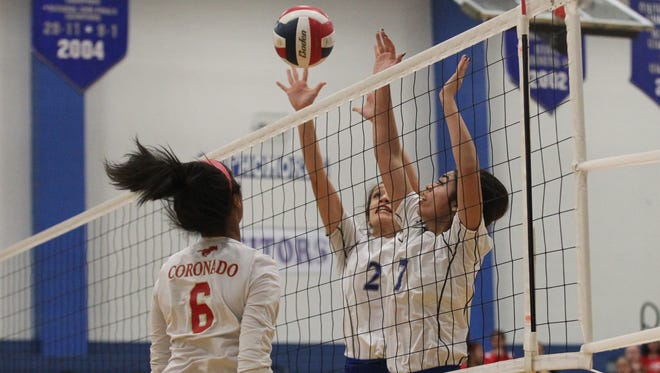 Lake View High School's Angel Arroyo (7) and Kristena Watson (2) go up for a block attempt against Lubbock Coronado's Catelyn Vargas in District 4-5A volleyball action Tuesday, Sept. 26, 2017, at Ben Norton Gym at Lake View.