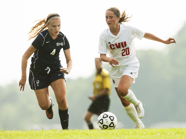 CVU's Sydney Jimmo (20) runs past Burlington's Hannah Minall (4) during a high school girls soccer game last week.