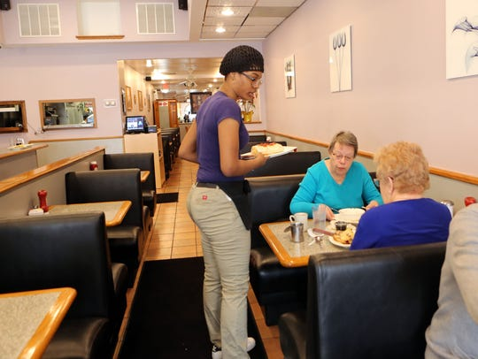 A waitress serves customers at Yonkers Diner March