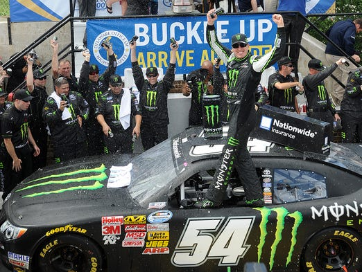 Kyle Busch celebrates his Nationwide Series victory Saturday at Dover.