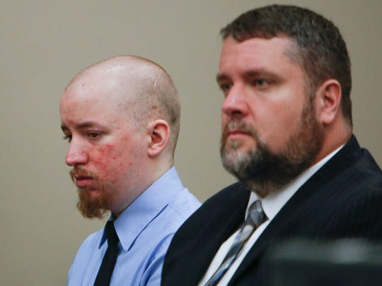 Thomas McClellan, left, sits with his attorney Patrick