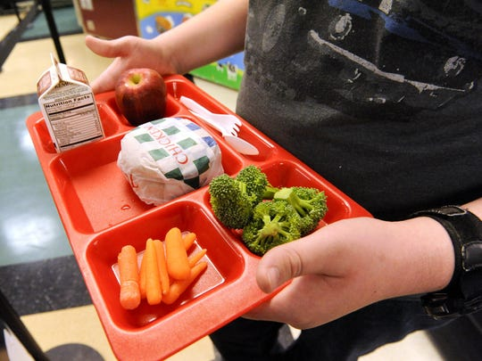 File - A tray of food is shown during lunch in the cafeteria at Wilson Junior High School in Manitowoc.
