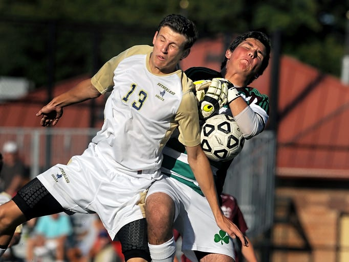 Pittsford Sutherland's Jack Ward, left, draws a foul as he collides with Aquinas goallkeeper Andrew Hoyt during Sutherland's 1-0 win at McAvoy Park on Friday, Aug. 29, 2014.