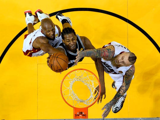 Miami Heat guard Ray Allen, left, and forward Chris Andersen block a shot by San Antonio Spurs forward Kawhi Leonard, center, in the second half in Game 3 of the NBA basketball finals in Miami, Tuesday, June 10, 2014. The Spurs won 111-92. (AP Photo/Larry W. Smith, Pool)