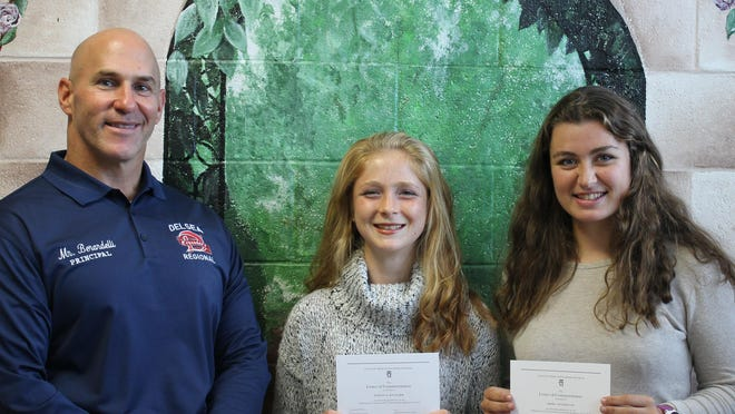(From left) Delsea Regional High School Principal Paul Berardelli and students Kaitlyn Rauscher and Sierra Weyhmiller.