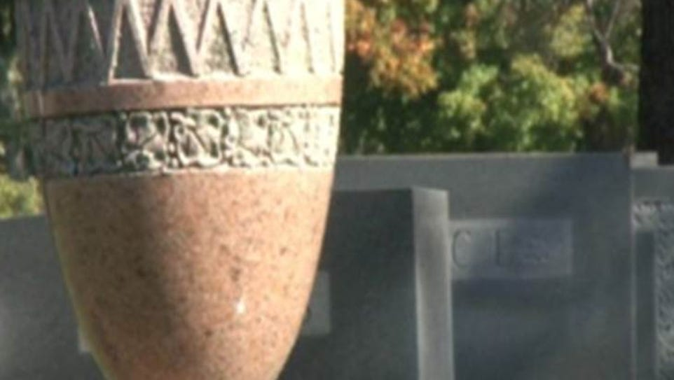 Urn holding cremated remains in cemetery