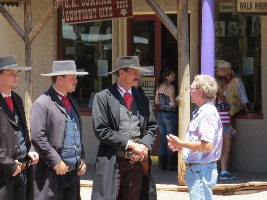 A visitor to Tombstone chats with historical reenactors