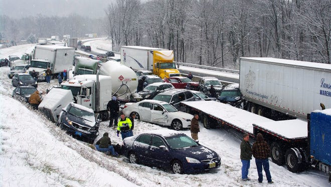Vehicles are piled up at mile marker 286 on the Pennsylvania Turnpike, a mile outside Reading, Pa. Portions of both the Pennsylvania Turnpike and Interstate 78 were shut down in snowy eastern Pennsylvania after chain-reaction pileups involved dozens of vehicles on slippery roads.