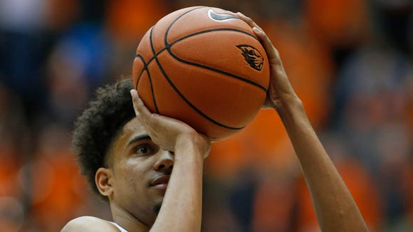 Oregon State's Stephen Thompson Jr. shoots the first of three free throws he made with not time left on the clock to give Oregon State an 71-69 win over Utah in an NCAA college basketball game in Corvallis, Ore., on Thursday, Feb. 4, 2016.