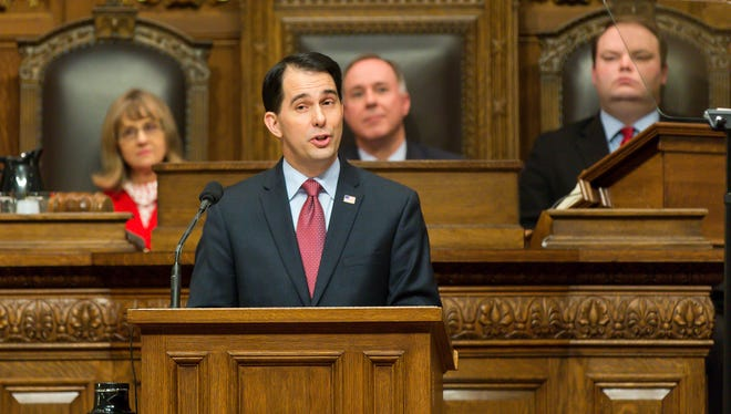 Gov. Scott Walker, center front, addresses a joint session of the state Legislature during the Governor's State of the State speech in the Assembly chambers at the state Capitol.
