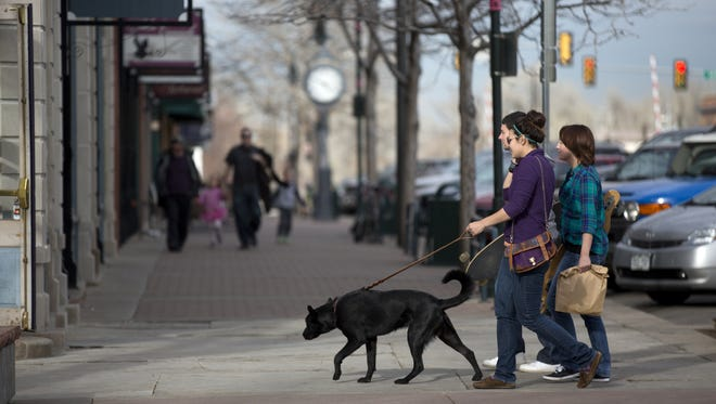 Shoppers walk in Old Town Fort Collins Monday, March 10, 2014.