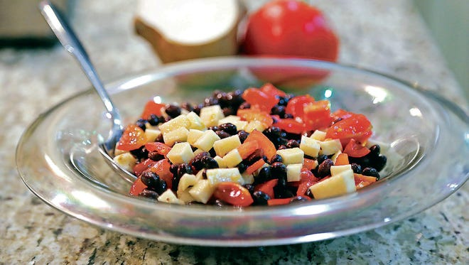 Black bean, jicama and tomatoes come together to make this delicious salad.