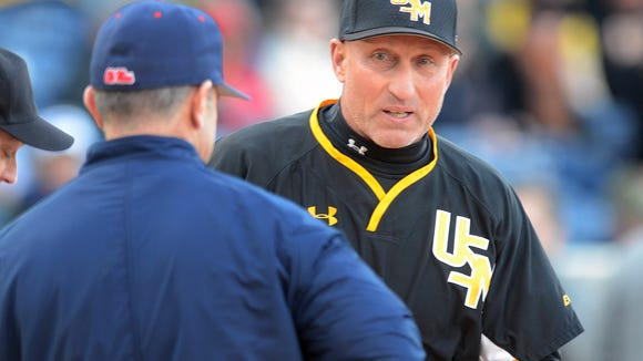 Ole Miss head coach Mike Bianco and Scott Berry meet at the plate during a game earlier this season.