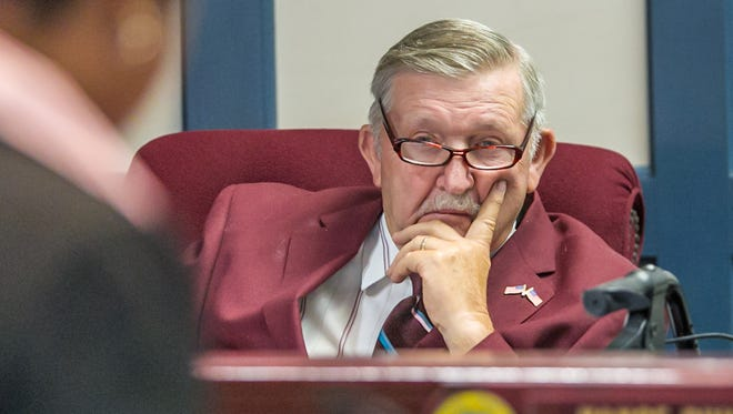 Councilman Sam Wilson listens during the public comment period at a recent Sussex County Council meeting.