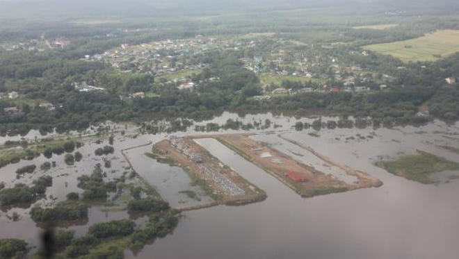 This Aug. 15, 2013, photo provided by the Russian Emergency Ministry, Khaabarovsk region branch, shows the aerial view of flooded Amur River in the Khabarovsk region.